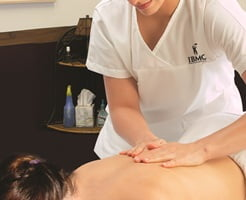 IBMC Massage Therapy Degree student performs a healing massage at the Fort Collins college clinic.