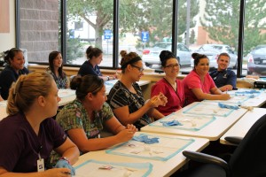 These students use hands-on training to prepare for a healthcare career.