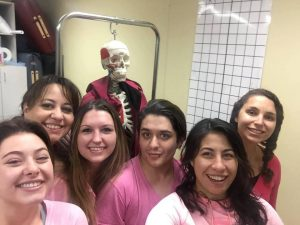 Students from the Fort Collins campus representing their pink in their Kinesiology class.