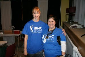 IBMC College students volunteer at the 9Health Fair in 2015.